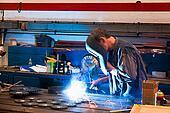 Welder in the workshop in the metal industry