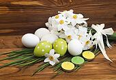 Easter eggs and white daffodils