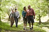 Hispanic family walking along trail in park