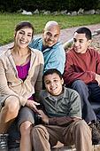 Portrait of Hispanic family outdoors