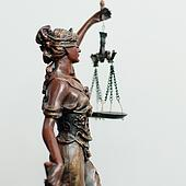 side of themis, femida or justice goddess sculpture on white