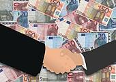 business handshake on euros