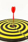 Red darts in bullseye of dartboard