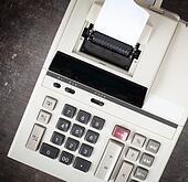 Closeup of an old dirty calculator