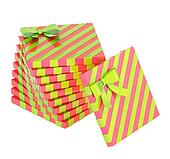 Twisted pile of gift boxes isolated