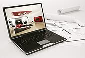 Laptop and blueprint of housing project 3d