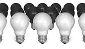 Row of white light bulbs in front of black ones