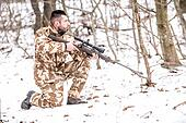 Military man in combat, camouflage uniform preparing for battle with enemy
