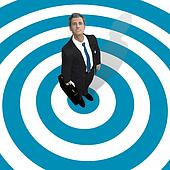 Business man in center of blue target
