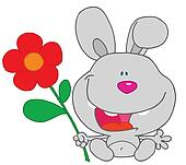 Happy bunny holds flower