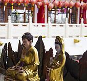 buddha and goddess of mercy statue