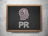 Marketing concept: Head With Gears and PR on chalkboard background