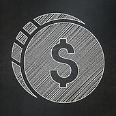 Money concept: Dollar Coin on chalkboard background