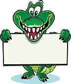 Crocodile holding sign