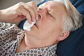 Older man suffers from bad cold.
