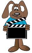 dog holding up directors clapboard
