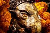 Golden face ganesha statue