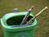 Green waste basket with used fireworks rockets