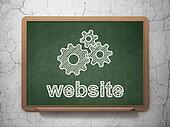 Web design concept: Gears and Website on chalkboard background