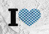 Love checkered  flag sign heart symbol on Cement wall texture ba
