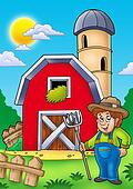 Big red barn with farmer