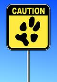 caution sign with paw print on blue sky