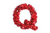 Red roses letter Q, isolated on white background