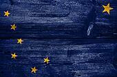 Alaska State Flag painted on old wood plank texture
