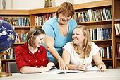 Friendly Teacher Helping Students