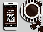 mobile phone with discount coupon, cup of coffee and gingerbread