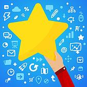 Man's hand holding a large yellow star on a blue background