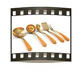 Gold cutlery. The film strip