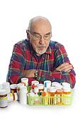 man with prescription bottles