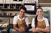 Waitress and waiter working at a cafe