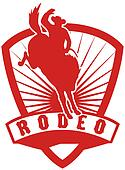 Rodeo Cowboy riding bucking bronco