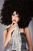 Futurism. Fanciful Girl in Huge Unusual Black African Frizzy Wig