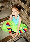 Preschool girl with tutu and candy sucker