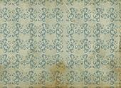 old and dirty wallpaper with blue arabesques and yellow and orange background