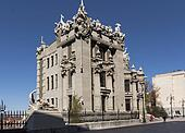 chimera house with stone gargoyle, demons, monsters on its roof and decoration gothic style photo