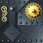 Gold gears against ferrous metal