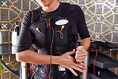 EMS electro stimulation suit woman