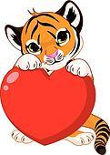 Cute  tiger cub holding heart