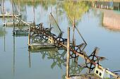 Many Hydraulic turbines in local pond