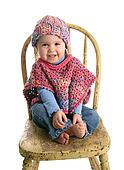 Cute baby in handmade clothing