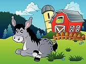 Lying donkey near farm