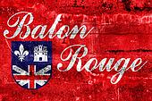 Flag of Baton Rouge, Louisiana, painted on dirty wall. Vintage and old look.
