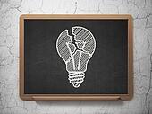 Finance concept: Light Bulb on chalkboard background