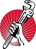 Plumber hand holding monkey wrench