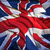 Flag of the United Kingdom, fluttering in the breeze, backlit ri