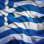 Flag of Greece, fluttering in the breeze, backlit rising sun